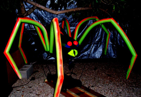 "Special EFX: A Giant walking ""Ultraviolet"" Spider (7' across!) thrills guests at a charity event. (Design © Mike Ching 2005)"
